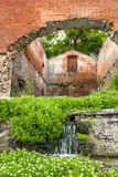 The ruins of the old brick building. With waterfall Royalty Free Stock Images