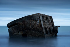 Ruins of old brick house. Barracks building in the Baltic sea. Stock Photo