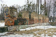 The ruins of the old brick house. Foundation and part of the brick wall of the destroyed house Royalty Free Stock Image