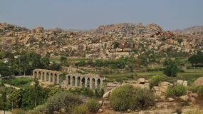 Ruins of an old Bridge and granite mountain in Hampi stock photo