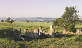 The ruins of the old bridge. Medieval Stock Photography