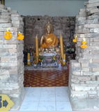 Ruins of old Buddhism temple in Thailand. The Buddha statue with the ruins of the bricks of the building of old Buddhism temple in Thailand, taken on August 26 Royalty Free Stock Photos