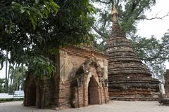 Ruins of an old Burmese temple. View of the ancient ruins of an old Burmese stone temple. In the ancient city of Inwa, Myanmar stock image