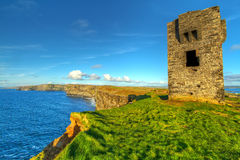 Ruins of old castle on Cliffs of Moher Royalty Free Stock Images