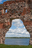 Ruins of an old castle Ludza with lake Royalty Free Stock Photos