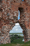 Ruins of an old castle Ludza with lake Stock Photos
