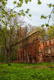 The ruins of the old castle made of brick in a clearing in the woods Royalty Free Stock Photography