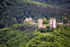 Ruins of old castle in the middle of the forest hills Royalty Free Stock Photo