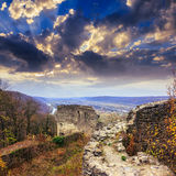 Ruins of an old castle in the mountains. Stone wall of an old ruined castle in the mountains Stock Image