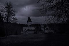Ruins of old castle in mystery moonlight. Stock Image