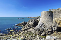 Ruins of old castle in Southern Coastline of Yeu Island. Ruins of old medieval castle of the Isle of Yeu make a part of wild coastline in South of Yeu Island Royalty Free Stock Images