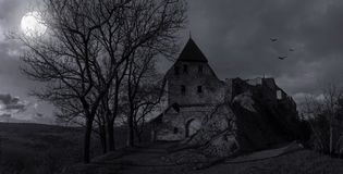 Ruins of old castle Tocnik in mystery moonlight. Royalty Free Stock Photography