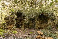 Ruins of an old chapel in the  woods. Ruins of an old chapel in the Veillon woods of Talmont Saint-Hilaire Vendee, France Stock Photo