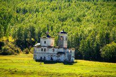 Ruins of old church. Eastern Siberia. Russia. Eastern Siberia. The photo is made from a train. Here in the beginning of XX century the imperial railway ran Royalty Free Stock Image