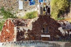 Ruins of old church on rock of Oia town at Santorini island, Greece.  Stock Photos