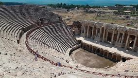 The ruins of old city debris of Turkish amphitheater. Archaeological Attraction. Ancient city Hierapolis near Marmaris. The ruins of old city. Debris of the stock video