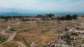The ruins of old city debris of Turkish amphitheater. Archaeological Attraction. Ancient city Hierapolis near Marmaris. The ruins of old city. Debris of the stock video footage