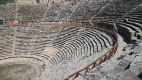 The ruins of old city debris of Turkish amphitheater. Archaeological Attraction. Ancient city Hierapolis near Marmaris. The ruins of old city. Debris of the stock footage