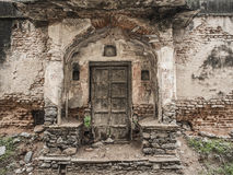 Ruins with old door. In a city of North India Stock Image