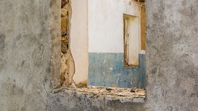 The ruins of an old earthen house without a roof. Holes in the wall at the site of windows and doors stock images