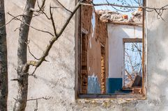 The ruins of an old earthen house without a roof. Holes in the wall at the site of windows and doors.  stock images