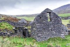 Irish Farmhouse Ruins on Mountain. Ruins of an old farm abandoned during the Irish Famine on Slea Head Drive, Dingle Peninsula, Ireland Stock Images