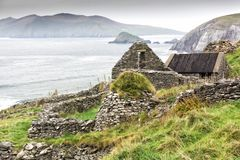 Irish Farmhouse Ruin on Cliff. Ruins of an old farm abandoned during the Irish Famine on Slea Head Drive, Dingle Peninsula, Ireland Stock Images