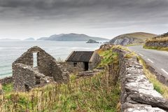 Irish Farmhouse Ruins on Cliff Road. Ruins of an old farm abandoned during the Irish Famine on Slea Head Drive, Dingle Peninsula, Ireland royalty free stock photography