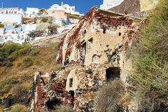 Ruins of old fortress on rock of Oia town at Santorini island Royalty Free Stock Photos