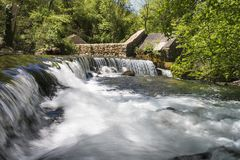 Waterfalls on Grab river. Ruins of old grain mill on river Grab near town Trilj in Croatia Stock Image