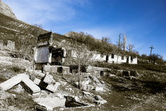 The ruins of an old house against the blue sky Royalty Free Stock Image