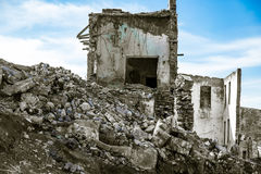 The ruins of an old house against the blue sky Royalty Free Stock Images
