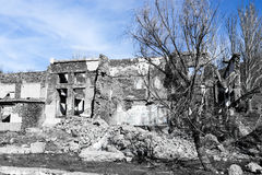 The ruins of an old house against the blue sky Stock Photos
