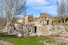 The ruins of an old house against the blue sky Royalty Free Stock Photo