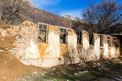 The ruins of an old house against the blue sky Royalty Free Stock Photos