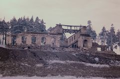 The ruins of an old house on a hillock. Infrared photo. The ruins of an old house on a hillock. Urals mining zone, Russia. Infrared photo royalty free stock image