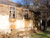 The ruins of an old house in nature Royalty Free Stock Image