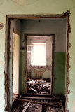 Ruins of an old house with window light. Building in need of demolition Royalty Free Stock Images