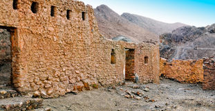 Ruins of old houses in village Chebika Stock Photo
