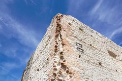 Ruins of old medieval castle . fortified wall and tower detail brick.  Royalty Free Stock Image