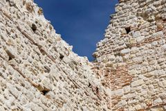 Ruins of old medieval castle . fortified wall and tower detail brick.  Royalty Free Stock Photos