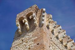 Ruins of old medieval castle . fortified wall and tower detail brick Stock Photos