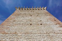 Ruins of old medieval castle . fortified wall and tower detail brick.  Royalty Free Stock Photo
