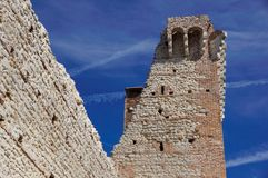 Ruins of old medieval castle . fortified wall and tower detail brick.  Royalty Free Stock Images