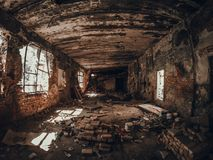 Ruins of old red brick abandoned building inside interior, dark creepy corridor Stock Photo