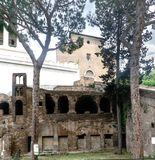 Ruins of an old Roman house called. `Insula Romana` on the street called the Teatro di Marcelo. Behind the Church of Ara Coeli in Rome, Italy Royalty Free Stock Photos
