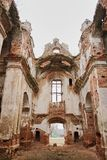 ruins of an old ruined church. red brick, ruined arches stock image