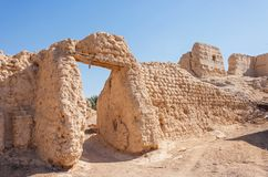 Ruins in an Al Ain Oasis. Ruins of an old settlement in an oasis in Al Ain, in the emirate of Abu Dhabi, United Arab Emirates Stock Image