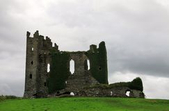 Ruins of an old stone castle in Ireland. Old castle ruins with damaged stones and ivy on Valentia Island in Ireland Stock Image
