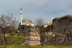Ruins of old walls of Constantinople and Mihrimah Sultan Mosque in Istanbul, Turkey Stock Photography